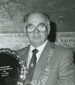 Lord Provost Robert Gray, photographed for the February 1987 issue of Glasgow City Council's newspaper The Bulletin presenting the Glasgow's Sportsperson of the Year 1986 trophy to Scottish badminton internationalist Dan Travers. Image Credit: Mitchell Library, Glasgow Collection, Bulletin Photographs.